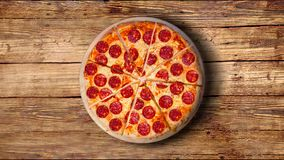 A video of the background pepperoni pizza. Footage. stock video