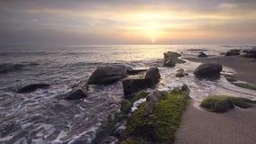 Sea rocks at sunrise stock footage