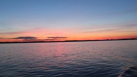 Beautiful sunset shot from a boat on a lake. Video of beautiful sunset shot from a boat on a lake stock video footage