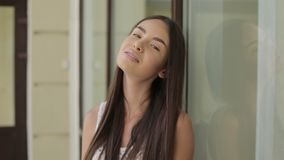 Beautiful young woman with dark hair smiling on camera stock video