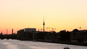 Berlin skyline silhouetted at sunset stock video footage