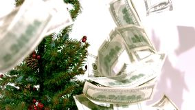 Bills on christmas tree slow motion stock footage