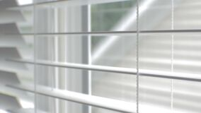 Blinds on a window being opened and closed. Video of blinds on a window being opened and closed stock footage