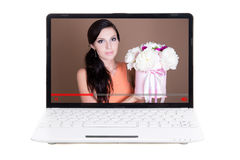 Video blog concept - beautiful girl talking about flowers on lap. Video blog concept - beautiful girl florist talking about flowers on laptop screen background Stock Photography