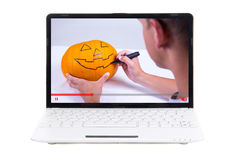 Video blog concept - man showing how to make jack-o-lantern for Stock Photos