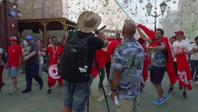 Video blogger makes video about fans from Tunisia. In centre of Moscow stock footage