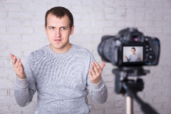 Video blogger making video over white wall Royalty Free Stock Photos