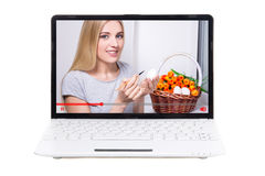 Video blogger talking about easter eggs on screen of laptop isol Royalty Free Stock Photo