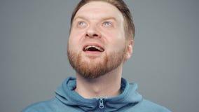 Video of blond man in blue sweatshirt with insight, portrait