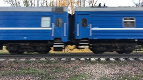 Video blue passenger train rides in the afternoon city Minsk. Blue passenger train rides in the afternoon city Minsk stock video
