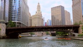 Boat passing under a bridge on the Chicago River. Video of boat passing under a bridge on the Chicago River stock video footage