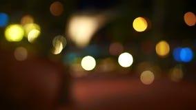 Video bokeh del fondo di festa di illuminazione colourful che riflette sullo specchio video d archivio
