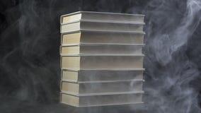 Video of books among smoke stock footage