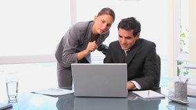Video of business people working together. In a bright office stock footage
