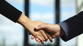 Video businessmans handshake. Successful businessmen handshaking after good deal stock photo