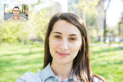 Video Call Of Pretty Young Girl With Young Man Royalty Free Stock Image