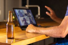 Free Video Call With Several Friends From Home While Having A Beer. Selective Focus Royalty Free Stock Photo - 186040125