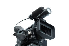 Video camera. Professional digital video camera isolated Royalty Free Stock Photography