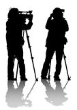 Video camera. Drawing of the operator with a video camera. Silhouettes on white background Stock Images