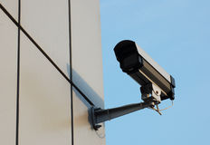 Video camera. Security video camera on the corner of building royalty free stock images