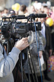 Video camera. Covering an event with a video camera Royalty Free Stock Photography