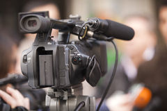 Video camera. Covering an event with a video camera Royalty Free Stock Photos