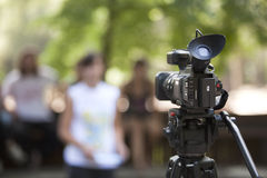 Video camera. Covering an event with a video camera Royalty Free Stock Images