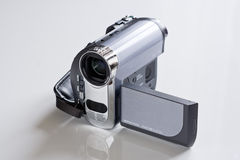 Video Camera. Mini DV camera isolated on white background with 16:9 wide lcd display open Royalty Free Stock Photos