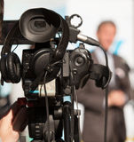 Video camera. Covering an event with a video camera Royalty Free Stock Photo