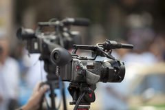 Video camera. Covering an event with a video camera Stock Image