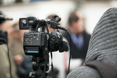 Video camera. Covering an event with a video camera Royalty Free Stock Image