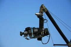 Video camera. Professional digital video camera, sky background Royalty Free Stock Photos