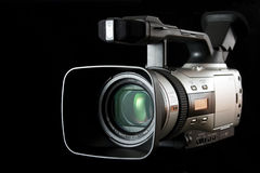 Video camera. Semi-professional video camera on black background. Other high quality versions available in my portfolio Royalty Free Stock Photo