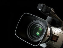 Video camera. Semi-professional video camera isolated on black background. Other high quality versions available in my portfolio Royalty Free Stock Photo