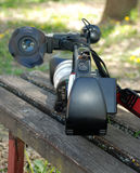 Video camera on a bench. Picture of Video camera on a bench Royalty Free Stock Photography