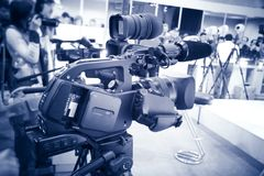 Video camera blue tint. Professional video camera at the exhibition. Blue tint Royalty Free Stock Photography
