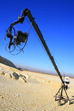 Video Camera On Boom. Video camera on a boom at desert location with blue sky