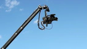 Video Camera On Boom Against Blue Sky stock video