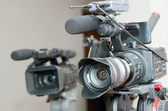 Video camera. Close up of professional  video camera lens in interior Royalty Free Stock Image