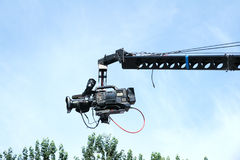 Video camera. The close-up of a video camera on rocker arm Stock Photo
