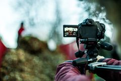 Video camera filming on a crane stock image