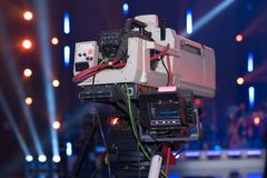 Video camera for filming events for a mobile TV studio. A large video camera for filming events for a mobile TV studio royalty free stock photography