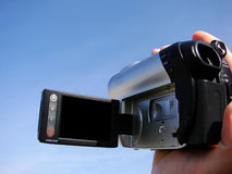 Video camera is in a hand Royalty Free Stock Images