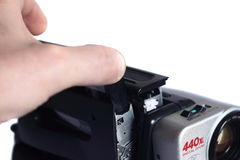 Video camera inserting tape B. Photograph of a person loading a tape into a video recorder stock photo