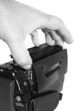 Video camera inserting tape C. Photograph of a person loading a tape into a video recorder royalty free stock photography