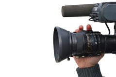 Video camera isolated. A hand is operating a professional video camera. Isolated royalty free stock photography