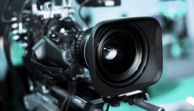 Video camera. Large professional black video camera filming TV stock photography