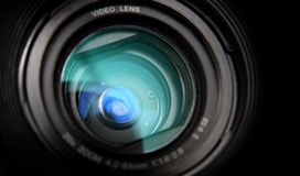 Video camera lens close-up. Close-up view on black video camera lens Royalty Free Stock Photo