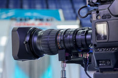 Video camera lens. Recording show in TV studio - focus on camera aperture Royalty Free Stock Photos