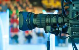 Video camera lens. Recording show in TV studio - focus on camera aperture Royalty Free Stock Image